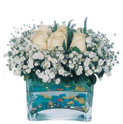 Niğde çiçekçi telefonları  mika yada cam içerisinde 7 adet beyaz gül