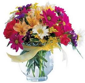 Niğde çiçek , çiçekçi , çiçekçilik  cam yada mika içerisinde karisik mevsim çiçekleri