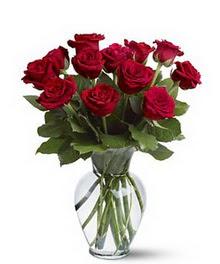 Niğde güvenli kaliteli hızlı çiçek  cam yada mika vazoda 10 kirmizi gül