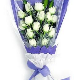 Niğde çiçekçi telefonları  11 adet beyaz gül buket modeli