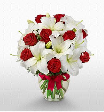 Niğde çiçek gönderme  1 dal kazablanka 11 adet kırmızı gül vazosu